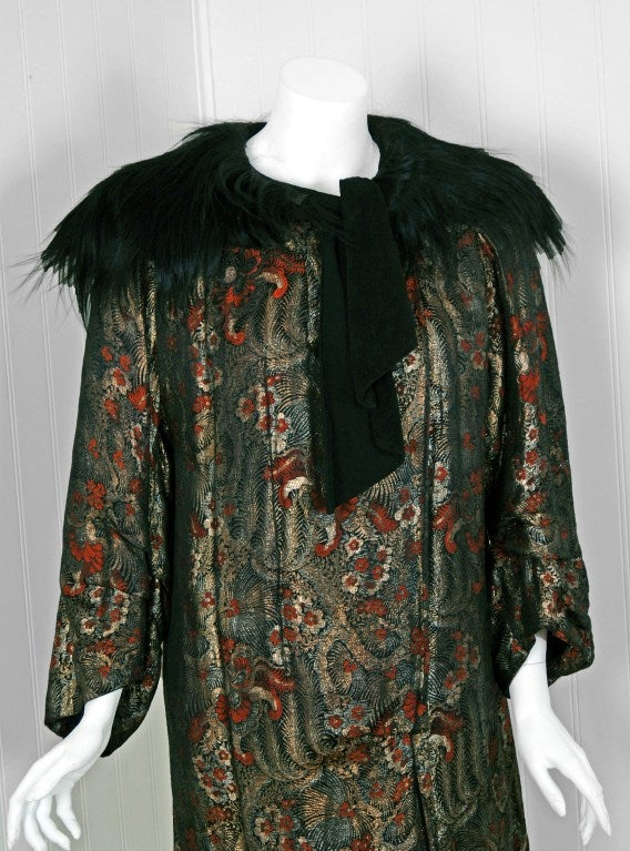 Treul on 15 rue de Castellane Paris was one of the elite couture houses operating during the art-deco era. This breathtaking garment, all hand-stitched, is fashioned in vibrant metallic-gold novelty feather-print lame and genuine monkey-fur. The