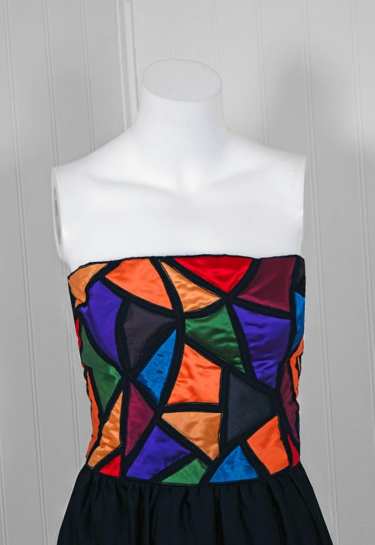 """An unbelievable and breathtaking 1970's Karl Lagerfeld for Chloe silk-satin evening dress. He uses an ingenious color blocking rainbow stained-glass effect which really gives the garments so much depth and texture. It is a """"not so subtle"""" design"""