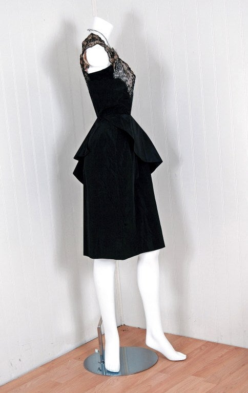 An amazing and highly stylized 1940's cocktail dress! The silhouette is classic pin-up