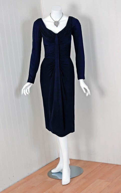 "Alluring ""Ceil Chapman"" designer cocktail dress in the most dramatic deep navy-blue color! I adore the heavily-ruched plunge bodice with a fitted hourglass nipped-waist. The sleeves have sexy zipper-wrists and the skirt is a seductive wiggle fit."