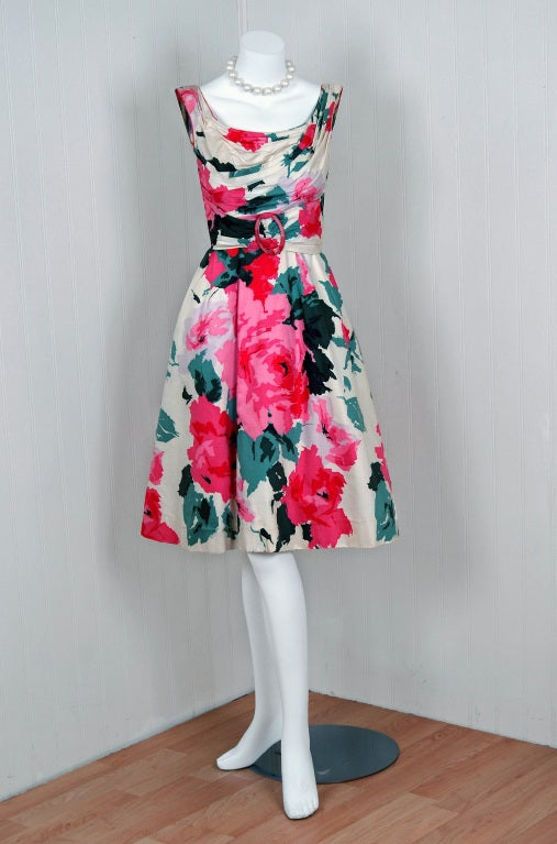 """This is such a romantic and dramatic cocktail-length sundress from the iconic """"Ceil Chapman"""" designer label. Perfect for any upcoming spring or summer party; you can't help but feel feminine in this beauty! The garment is fashioned from a vibrant"""