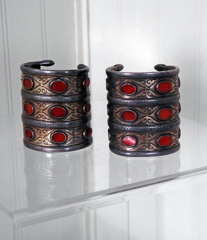 This gorgeous pair of heavy Persian silver & carnelian antique large cuffs with gold wash is unmarked but tests over 92% silver. Acquired from a family that emigrated to the US during the Iranian revolution; the bracelets had been in the family for