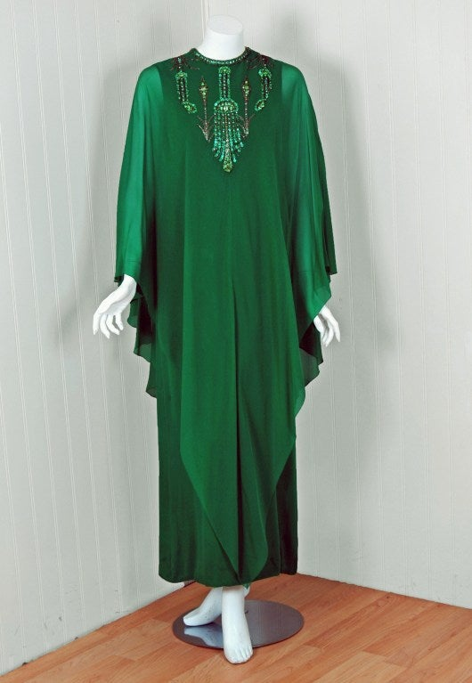 Spectacular 1965 Pierre Cardin haute-couture designer gown in the prettiest emerald-green lined silk-chiffon. In 1951 Cardin opened his own couture house and by 1957, he started a ready-to-wear line; a bold move for a French couturier at the time.