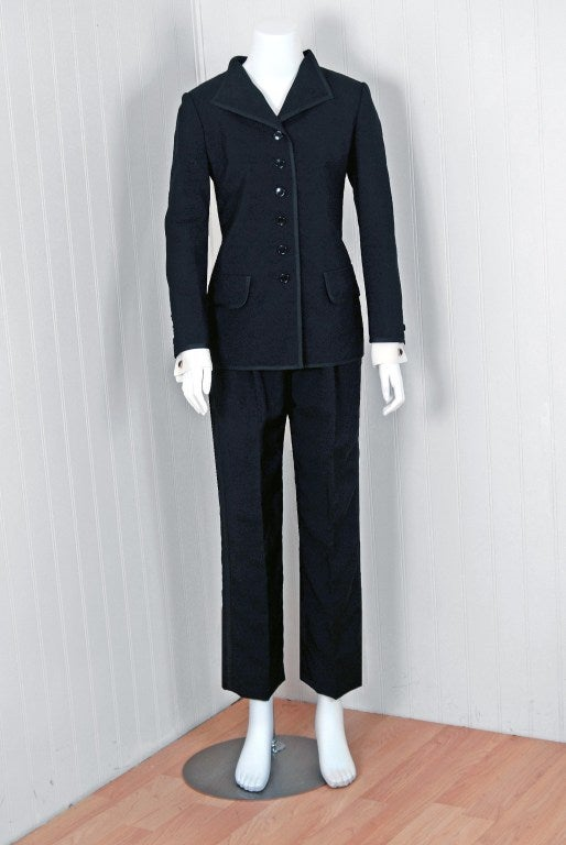 "First created in 1966 by famous couturier Yves Saint Laurent, the ""Le Smoking"" tuxedo suit for women was the first of its kind to earn attention in the fashion world and in popular culture. The silhouette pioneered long, minimalist,"