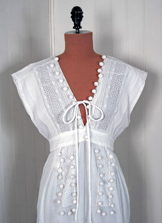 The house of Chloé is luxurious, romantic and quintessentially French. This marvelous sundress is an exemplar the Chloé style. I love the pairing of elegant crisp-white cotton & lace with a flirty low-plunge silhouette: refined ladylike fabrics with