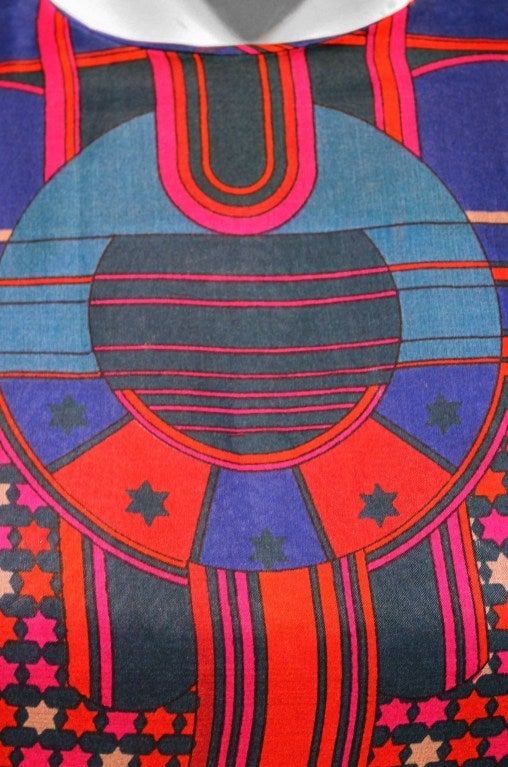 Spectacular late 1960's Pierre Cardin purse-silk maxi dress in a vibrant psychedelic silk-chiffon. In 1951 Cardin opened his own couture house and by 1957, he started a ready-to-wear line; a bold move for a French couturier at the time. The look