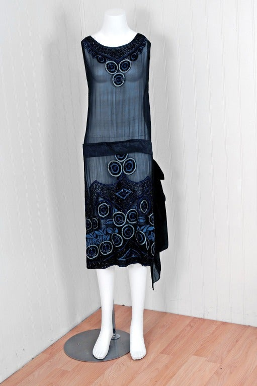 Breathtaking 1920's museum quality silk-chiffon evening dance dress. The ethereal black & blue color palette touches a deep chord in our collective aesthetic consciousness. As fashion lovers, we never tire from antique beadwork & embroidery; they