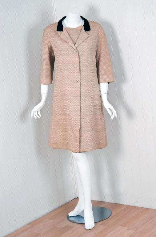Stunning 1962 Balenciaga ecru textured-silk cocktail dress with matching jacket. Cristobal Balenciaga began his life's work in fashion at a very young age. It is fabled that the Marquesa de Casa Torres, who was so taken with his talent, sent him to