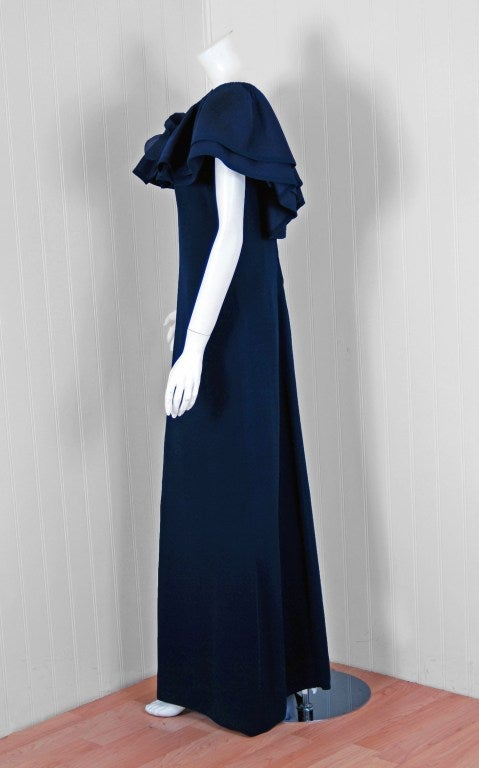 Breathtaking Pierre Balmain designer navy blue gown dating back to the 1973 fall-winter collection. Pierre Balmain worked under Robert Pigiuet, Molyneux, and Lucian Lelong, where he worked closely with Christian Dior. In 1945 he finally opened his