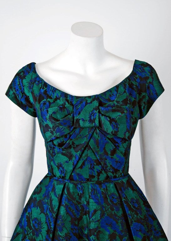 Early Michael Novarese garments are incredible rare and hardly go up for sale. In this gorgeous 1960's blue-green floral print silk-brocade party dress,the detailed construction and meticulous attention to detail are comparable to what you will find