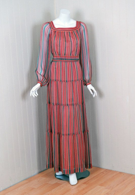 Givenchy, the name itself evokes glamour, refined elegance, simplicity and style. Givenchy's trademark of flowing lines and print fabrics make his work easily recognizable. This gorgeous rainbow-striped dress ensemble is a perfect example of his
