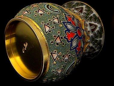 A SUPERB antique gilded silver and shaded cloisonne enamel vodka cup (charka) in the Russian Moderne style of the early 1900s by Peter Carl FABERGE, workmaster Feodor Ruckert.  Marked with 88 zolotnik standard (.916 silver) with initials of Moscow