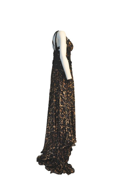 A beautifully silk chiffon leopard print with black satin beaded straps and multi-layer pleated floor-length evening gown. Zipper closure at side.