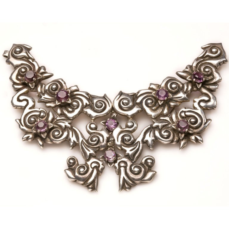 Magnificent and bold silver necklace is curvilinear throughout. It can be interpreted as abstract  ribbons and bows or as a butterfly motif.The leading authority on Mexican Silver believes this to be a piece created for a competition by Margot. The