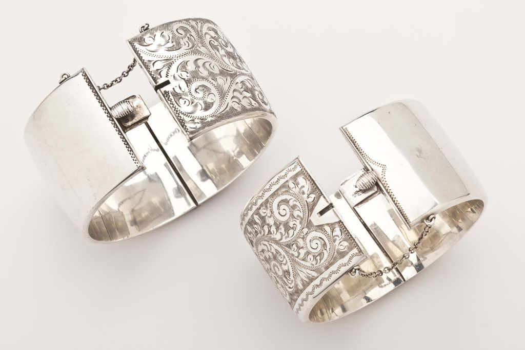 A Pair Of Victorian Floral Engraved Silver Cuffs In Excellent Condition For Sale In Hastings on Hudson, NY