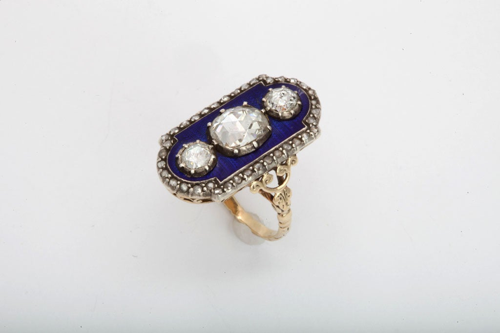 One of the most impressive of Georgian rings, one like is in the collection of the Victoria and Albert Museum and another is right here at Glorious. A lively, dark royal blue enamel is the background for three bright antique rose cut diamonds of