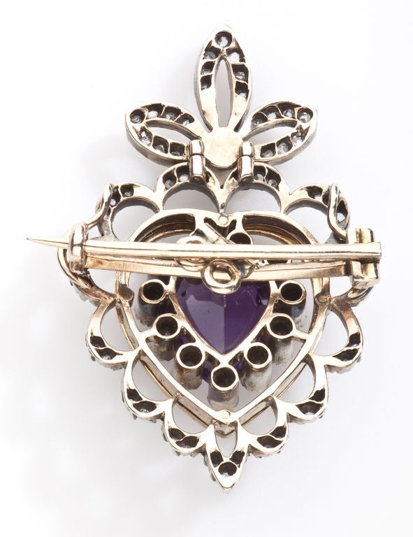 A regal 18 kt Edwardian diamond and amethyst pendant/brooch to exoresses your loving thoughts. Place it around a lady's neck and it sings magnificent quality. The amethyst gem is considered a spell caster, and the spell would be passion. Its