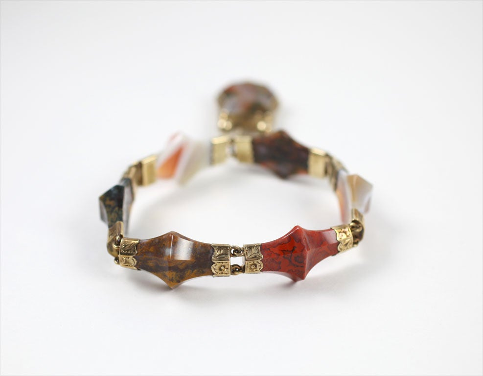 This rare agate  bracelet, sets in gold.  one of the best examples of stone sculpting I have found in Scottish jewelry. The stones as elongated pyramids or abstract bows. Image 6 shows the agate shapes perfectly. Click, if you will, on a close up of