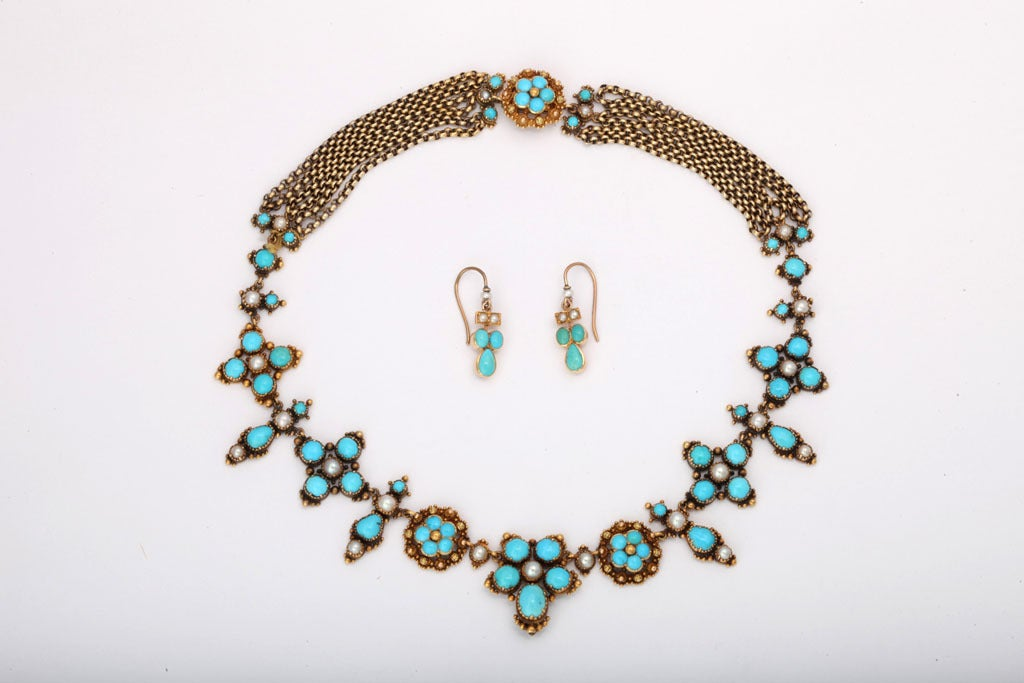 How exciting it was to discover this rare beauty of Persian turquoise and natural pearls, still resting in its original fitted box. A garden of blooms for the neckline, in clear blue and lustrous white, is joined at back by six strands of 18kt gold