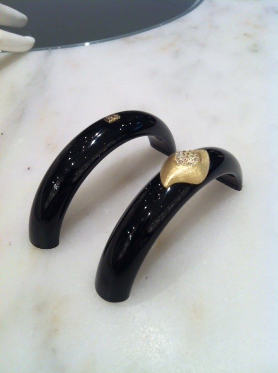Diamond Insight Cuff handcrafted by award-winning jewelry artist Susan Sadler, showcasing a vintage black bakelite bangle that separates into two pieces by strong and durable magnetic hinges, a signature of Susan's innovative focus on fine jewelry