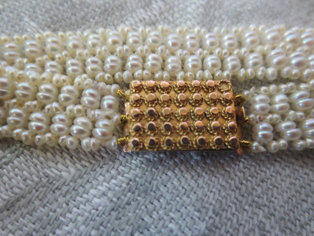 Contemporary Multi-Strand Unique Woven Seed Pearl Bracelet with Antique Gold Clasp For Sale