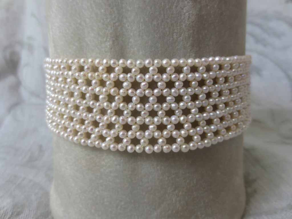 "2.5 - 3mm cultured pearls are intricately hand woven to create a delicate lace-like,hexagonal design. Choker measures 13"" in length and 1.25"" in height. Choker is tapered in design to fit along the curve of the neckline. Clasp is made of 14 k white"