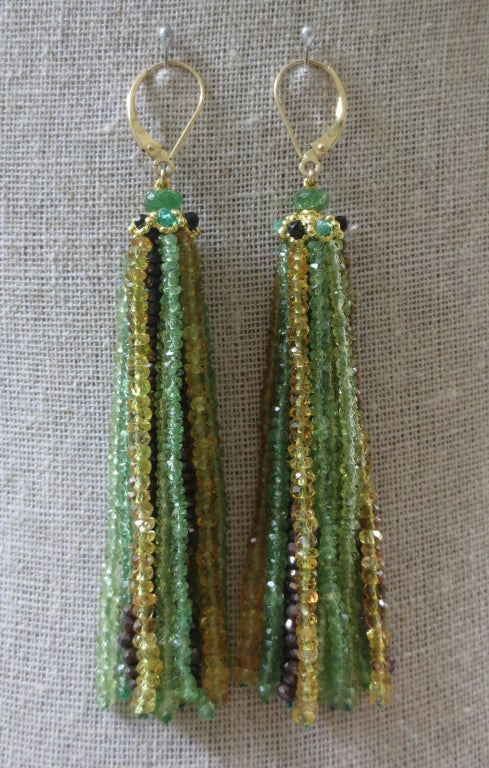 Reminiscent of beautiful green eyes with specks of yellow and brown, these delicate tassel earrings are the perfect accessory. Strands are made of tiny faceted tsavorite, peridot, citrine, beads measuring approximately 1mm each. The palate of colors