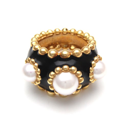 This is a 24kt gold ring from the inconinc 1982 Haute Joallerie collection. This is a truly beautiful, one of a kind vintage Chanel ring featuring authentic pearl insets and a real gold finish. This is a must have item for any Chanel