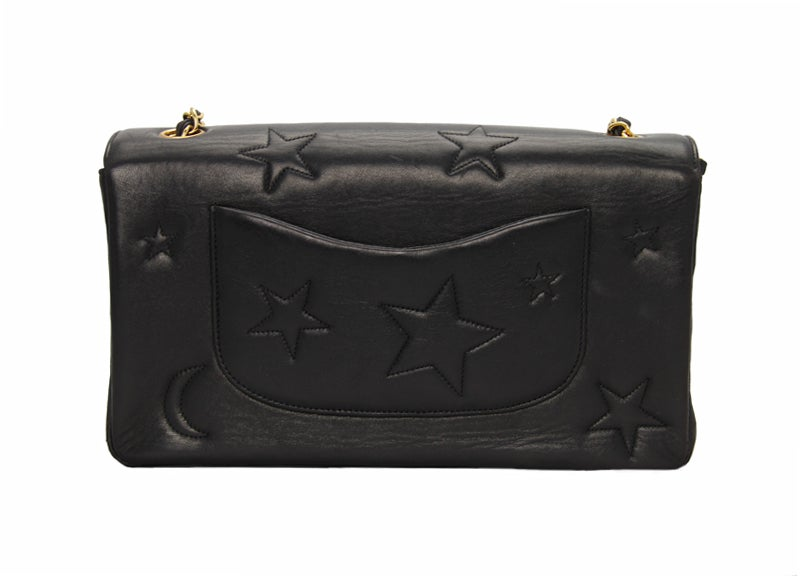 Beautiful black Chanel Bag with a black leather and gold tone shoulder strap and an inside zip pocket. The stitched star pattern makes this a perfect on-trend item for this season.  Returns Policy: Final Sale - No Returns.  All of our items are