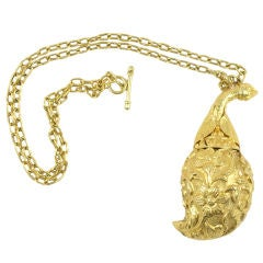 Gold Make-Up Pendant on Necklace
