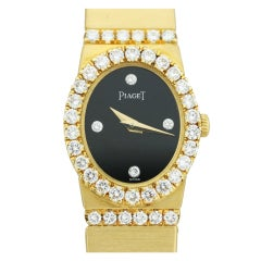 PIAGET Lady's Yellow Gold and Diamond Bracelet Watch with Onyx Dial