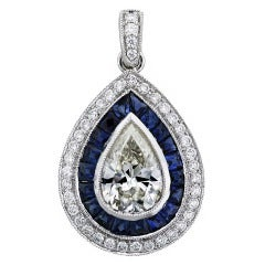 1 Carat Pear Shape Diamond and Sapphire Pendant in Platinum