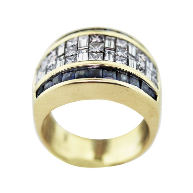 yellow gold sapphire and invisible set wide band
