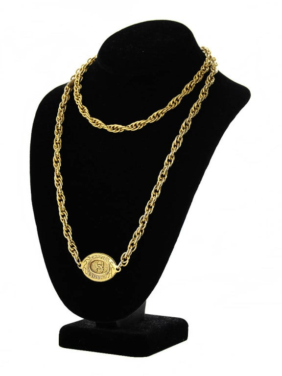 Necklace by Chanel features gold tone chain; with attached interlocking 'CC' logo 'CHANEL' oval plaque (Same on front and back). Label: Signed CHANEL 'CC' MADE IN FRANCE.