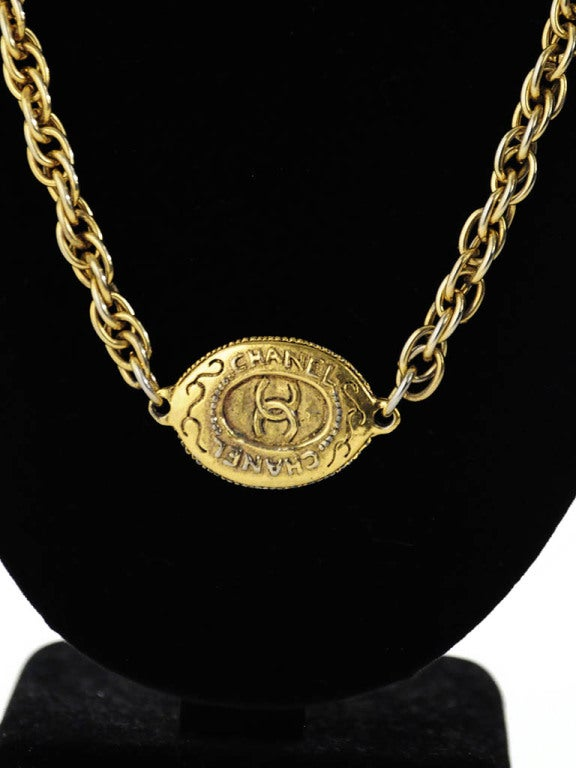Chanel Gold Tone Chain with Oval CC logo plaque In Excellent Condition For Sale In Boca Raton, FL