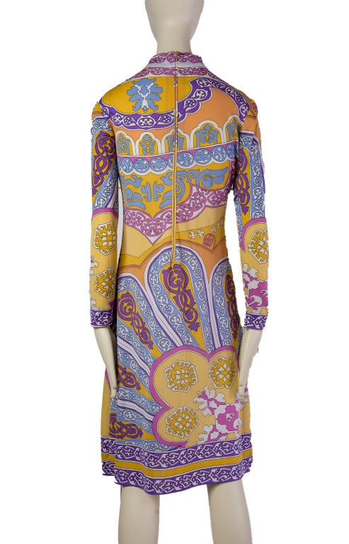 This is a beautiful vintage Leonard Fashion dress made in Paris. High neckline and full length sleeves in a bright, fun pattern. Zipper at back.