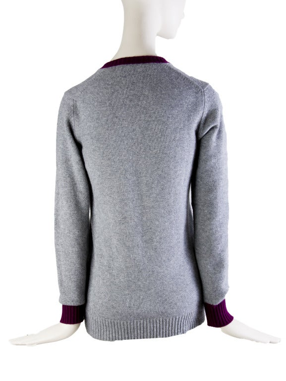 Chanel Sweater Prep School Style V-neck Maroon Trim Embroidered & Beaded Chanel Logo Patch Left Breast Long Sleeve 100% Cashmere Retailed at $2880
