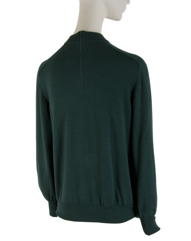 Presented here is a beautiful sweater from Hermes Paris. There is a silk front with an elaborate iconic Hermes pattern in colors of marvelous lime green, hunter green, red, burgundy, yellow, gold, gray, white, mustard, navy and teal. The sweater has