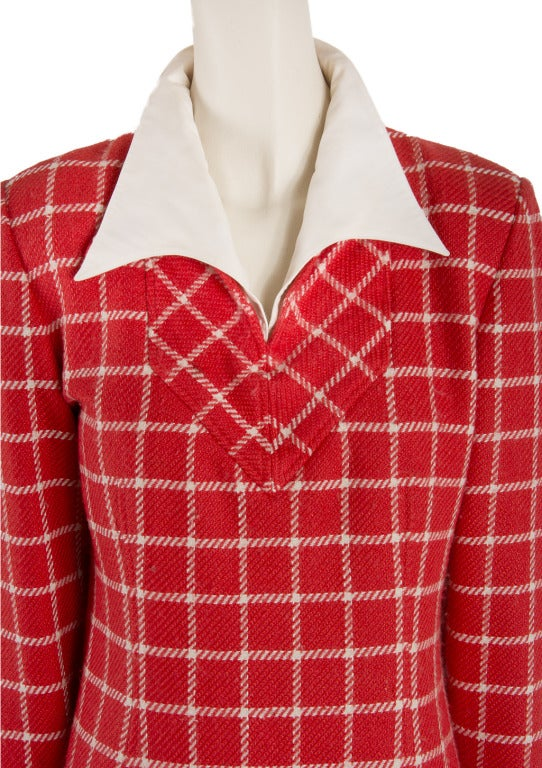 This vintage 1960's Valentino dress is presented in red wool with a white paid print and a white collar.  It is long sleeved and lined with a zip up the back. Size not marked, please see measurements. This dress was the property of Liona Helmsley.