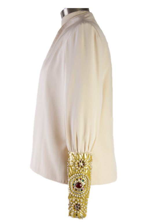 David Hayes Creme Beaded Silk Evening Jacket features gold, blue, green, red, pink crystal ab and pearl intricate beading on each sleeve.  This evening jacket has built in shoulder pads and no closure.  It is 100% silk and is a marked size 8.