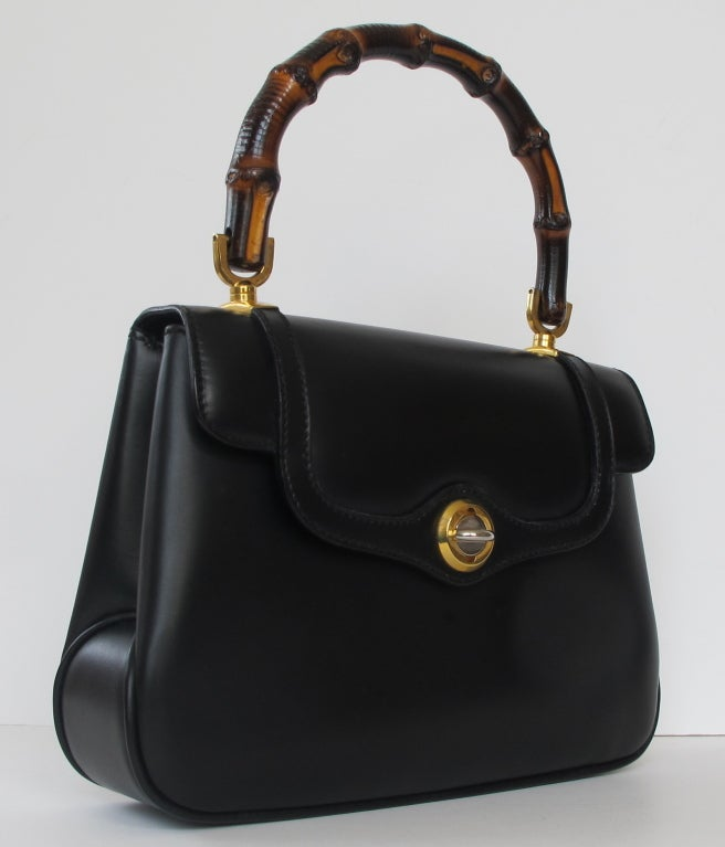 89b0d5d61dc84 1970 s New Gucci Black Leather Handbag at 1stdibs