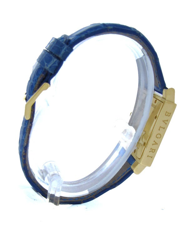 26615dd582f Lady s 18k yellow gold square Bulgari Quadrato wristwatch on original blue  strap with 18K yellow gold