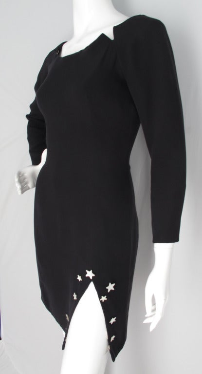 1988 Geoffrey Beene black silk dress featuring a knee-high slit adorned with mother-of-pearl stars. Constructed out of two layers of silk with the neck, cuffs and hem lined with silk charmeuse in a pattern of sun, moon and stars. And zippers at the