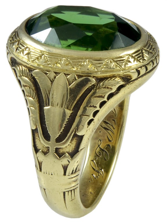 A Green Tourmaline and Gold Ring 2