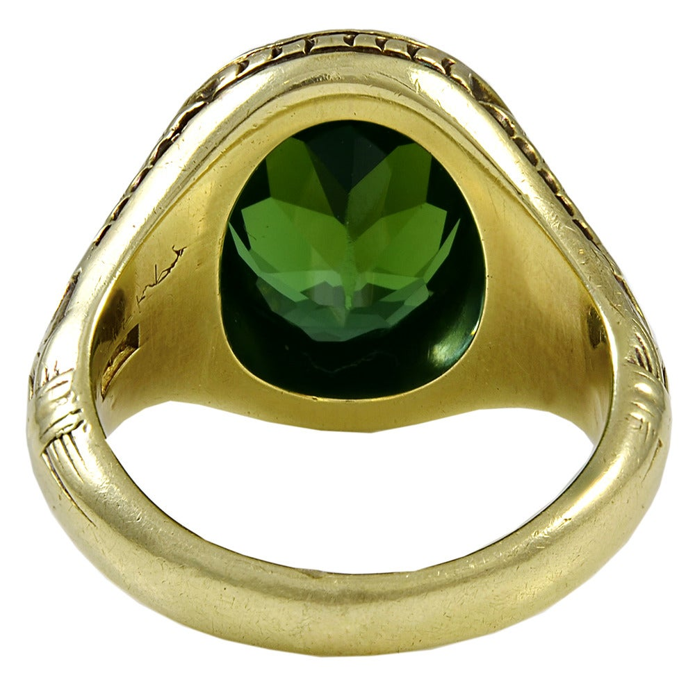 A Green Tourmaline and Gold Ring 3
