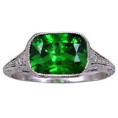 A DEMANTOID GARNET & DIAMOND RING