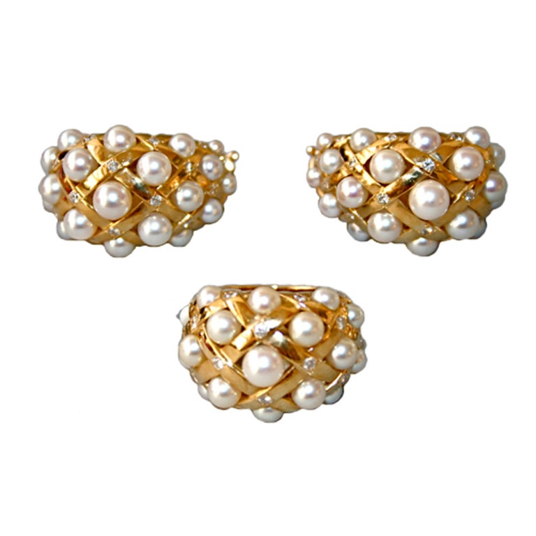 chanel gold diamonds and pearl earrings and ring set at