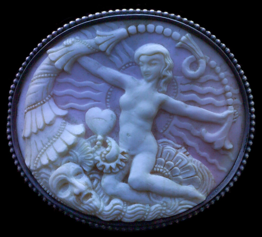 An exceptional Symbolist cameo brooch of Venus surrounded by the horn of plenty by the master goldsmith Karl Berthold & his painter wife Maria Schmidt-Kugel. Karl Berthold (1889-1975) came from a family of goldsmiths in Bavaria where he was