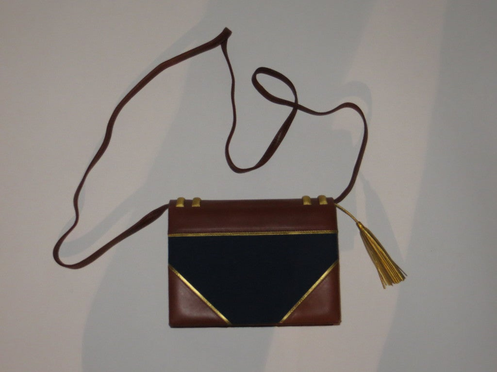 Paloma Picasso gold and brown leather trimmed navy blue fabric shoulder bag or hand carried bag.