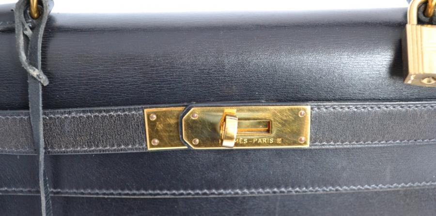 Hermes Kelly 28 black box with gold hardware at 1stdibs